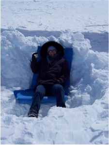 Katy Farness enjoys a cup of coffee in a snow pit